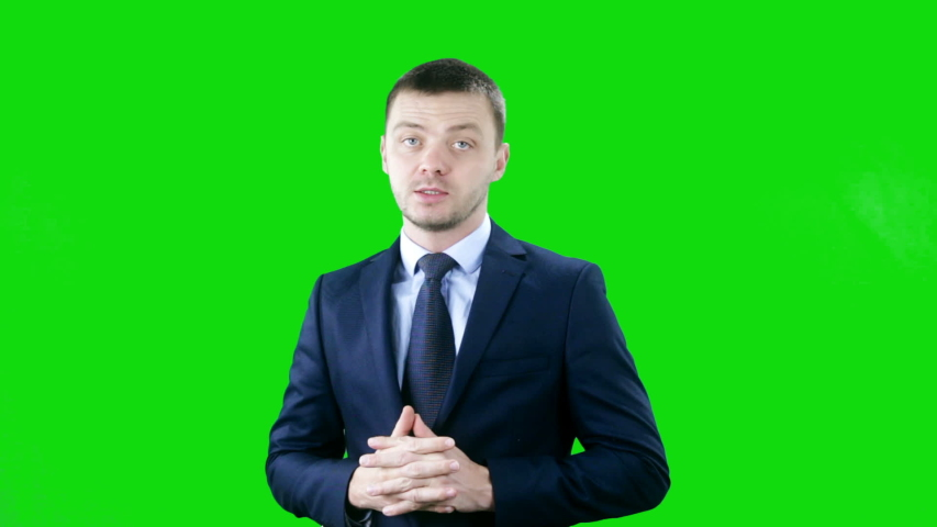 Man presenting on Green Screen, TV media, anchor concept | Shutterstock HD Video #1043310802