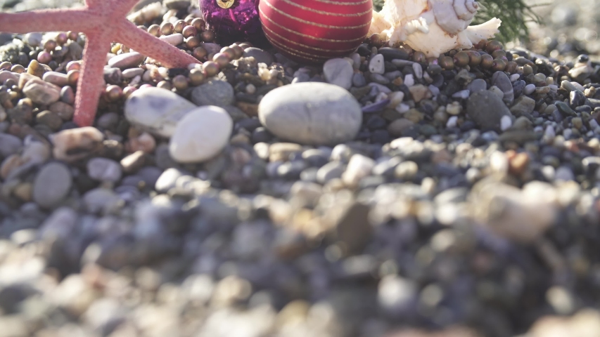 Christmas toys on the beach of tropical resort on the beach. Concept could be used for New Year and Christmas | Shutterstock HD Video #1043315047