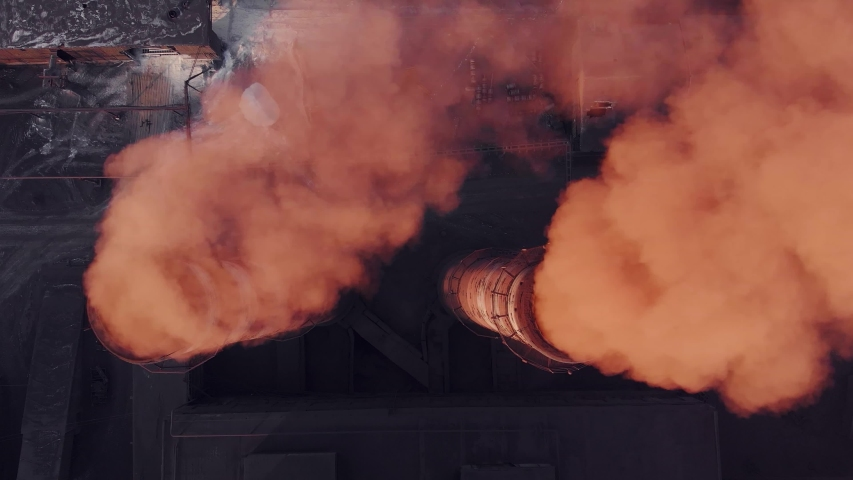 Epic aerial of high smoke stack with red emission. Plant pipes pollute atmosphere. Industrial factory pollution, smokestack exhaust gases. Industry zone, thick smoke plumes. Climate change, ecology | Shutterstock HD Video #1043331121