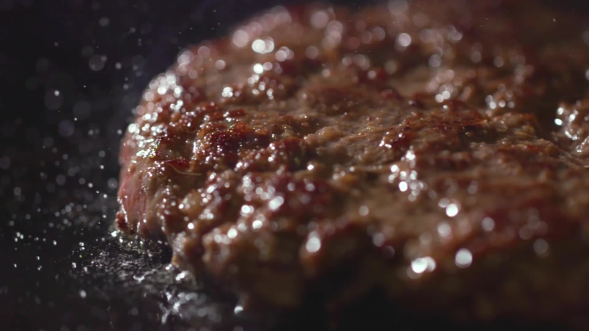Cooking beef and pork patty for burger. Meat roasted at kitchen. Slow motion.