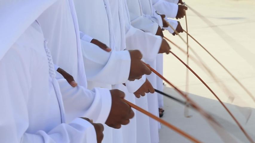 Traditional Emirati Yawalah male dance, UAE heritage, hands in frame   Shutterstock HD Video #1043340097
