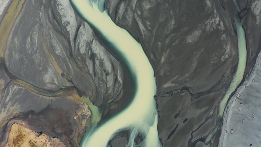 Aerial view of patterns of Icelandic rivers flowing into the ocean. Iceland in early spring | Shutterstock HD Video #1043371522