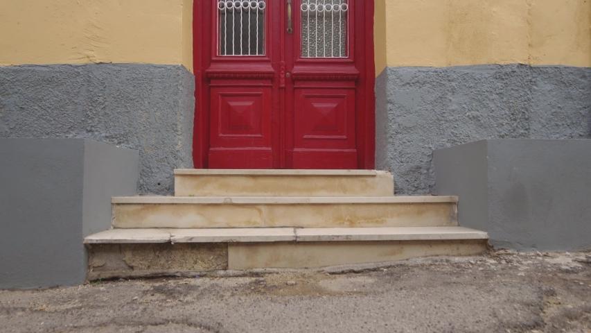 Red wooden door in Corfu Town on the island of Corfu, Greece   Shutterstock HD Video #1043391703