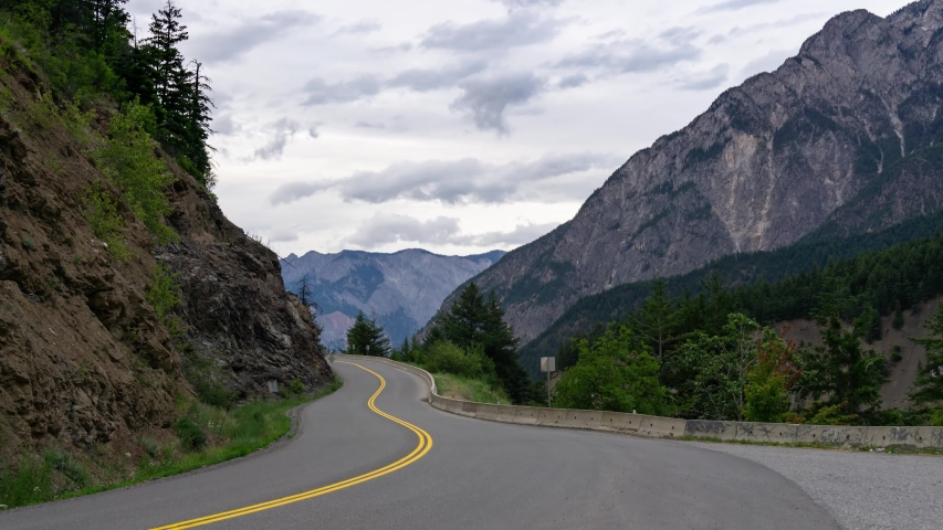 Time Lapse of Windy Road in the mountains of British Columbia. Taken on Duffey Lake Rd near Lillooet, during a cloudy early morning.