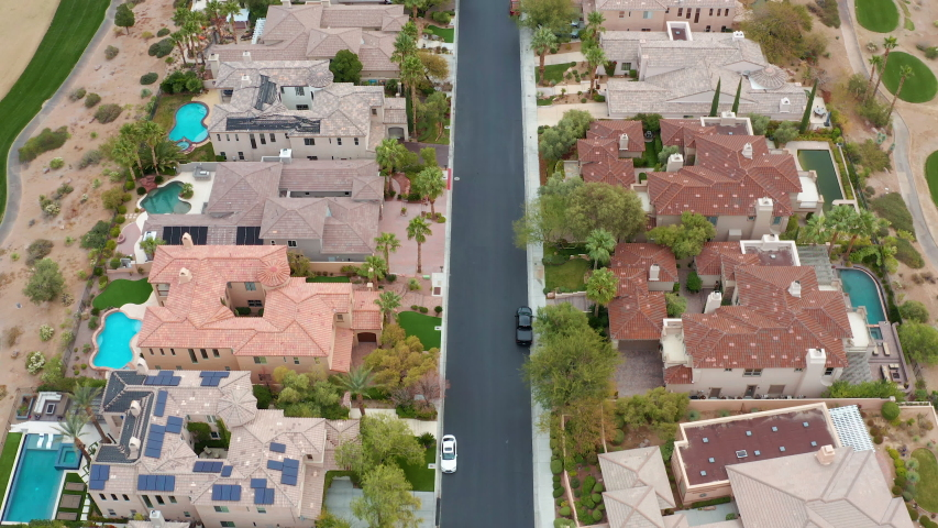 Aerial fly over of big Las Vegas suburban houses, mansions next to golf course | Shutterstock HD Video #1043431015