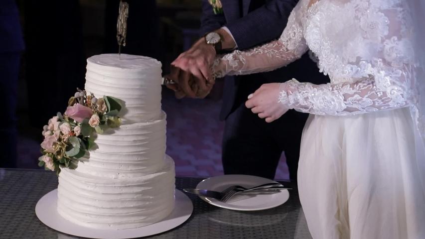 The Bride And Groom Cut Their Wedding Cake Hands Of The Bride And Groom Cut A Piece Of Wedding Cake Beautiful Wedding Cake