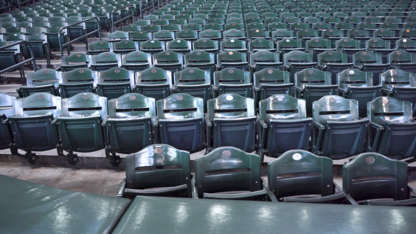 Indoor Stadium Seating with Hundreds of Empty Green fold up seats. | Shutterstock HD Video #1043452981