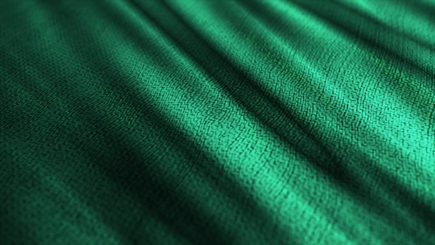 Green wavy fabric cloth. Textile cloth material, close up macro shot drapery.