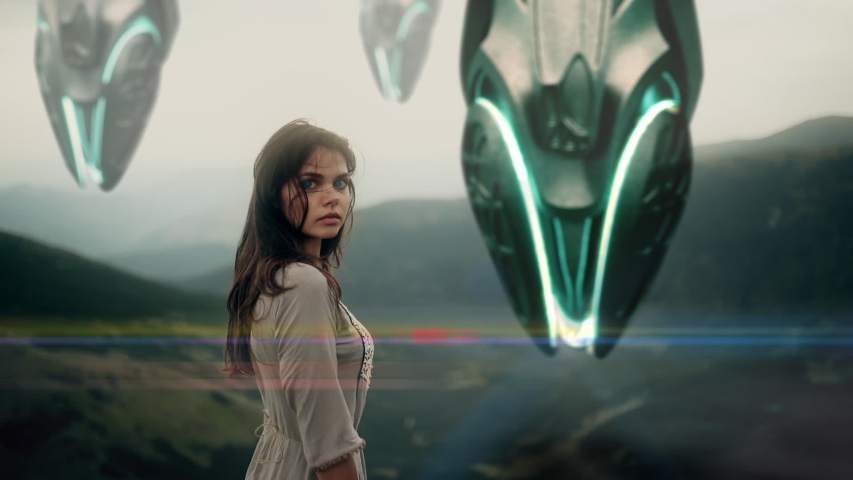 Young girl stands on top of a mountain on a background of landing spaceships. Alien spacecraft, star ship | Shutterstock HD Video #1043488315
