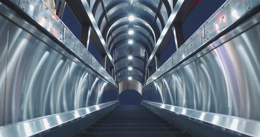 Futuristic escalator at night in Shinjuku Tokyo with no people 4K DCI slow motion Royalty-Free Stock Footage #1043528278