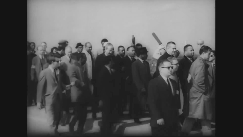CIRCA 1965 - Martin Luther King leads a peaceful march through Selma, and is granted the right to pray.