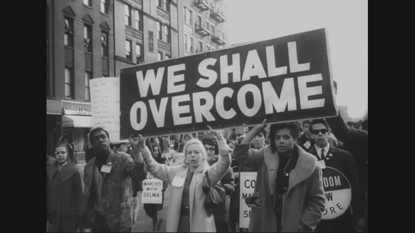 CIRCA 1965 - Civil rights demonstrators march in Harlem in support of Selma.
