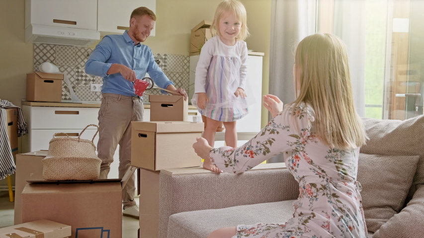 Active Family Group Move in Rent Real Estate. Positive Looking at Relocating or Unpacking of Carton Pack by Playful Family. Little girl jumps on hands to mom. Enjoying Life or Dream of Small Child by #1043564152