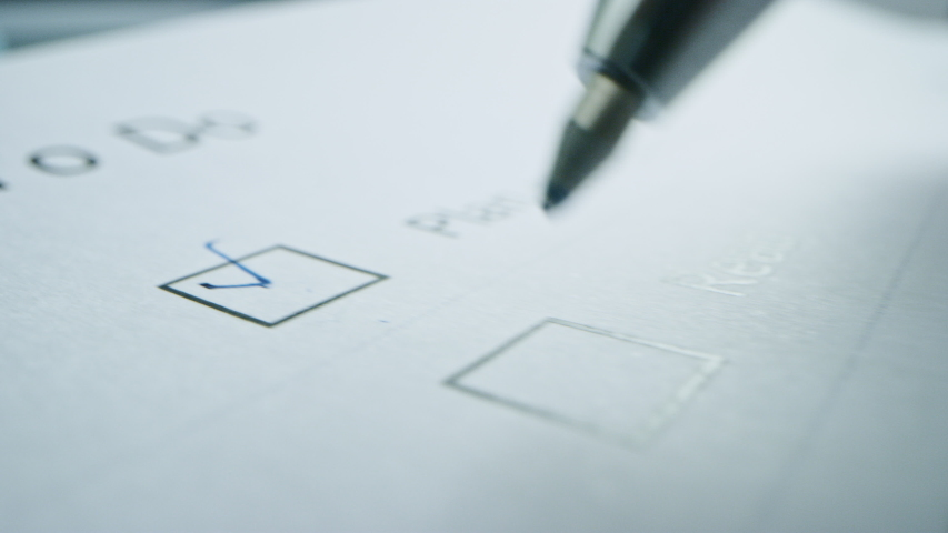 Person Ticks Checkbox Marks with a Pen, filling up To Do List. Checking Marks and FIlling in a Task List / Questiannaire / Medical Cart. Moving Macro Close-up Camera | Shutterstock HD Video #1043584978