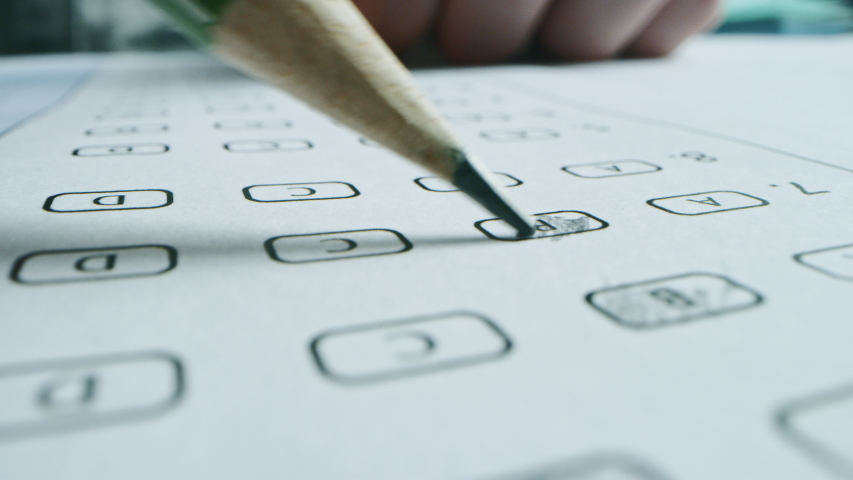 On Exam Test Person Colors Right Answers with a Pencil. Filling up Answer Sheet with Standardized Tests, Marking Correct Answer Bubbles. Macro Close-up Footage Royalty-Free Stock Footage #1043584990