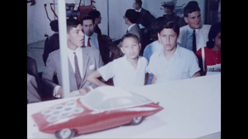 CIRCA 1964 - Crowds watch in awe as a small car is powered by a flashlight at the New York's World Fair.
