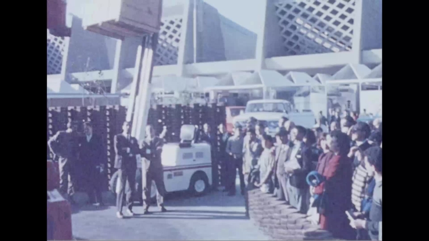 CIRCA 1964 - Bulldozers and forklifts are demonstrated at the New York's World Fair.