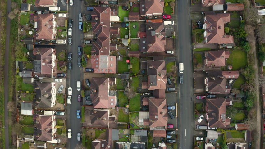 Aerial 4K fly over houses and gardens in Chester City, Cheshire, UK on Christmas Day, December 2019
