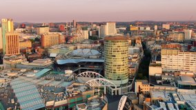 aerial shot drone of birmingham city centre at sunrise flying backwards rising up england uk