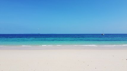 amazing Phuket Thailand tropical island beach,View of beach sea on sun light in the summer,Blue turquoise sea and white sand background.4K Video Clip