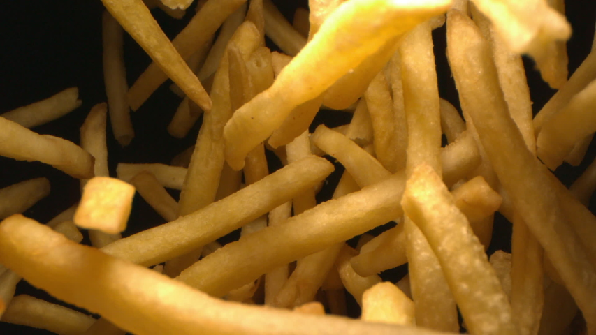 French Fries or Chips Floating in the Air Flying in Slow Motion on Black Background at 1500 fps 1080 version