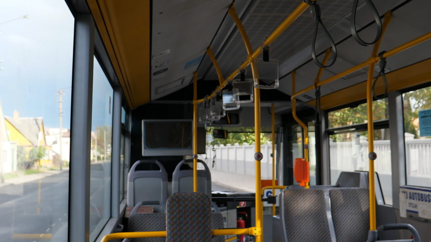 Blurred view of empty bus interior and street travelling in the town bus in Panevezys, Lithuania. | Shutterstock HD Video #1043635045