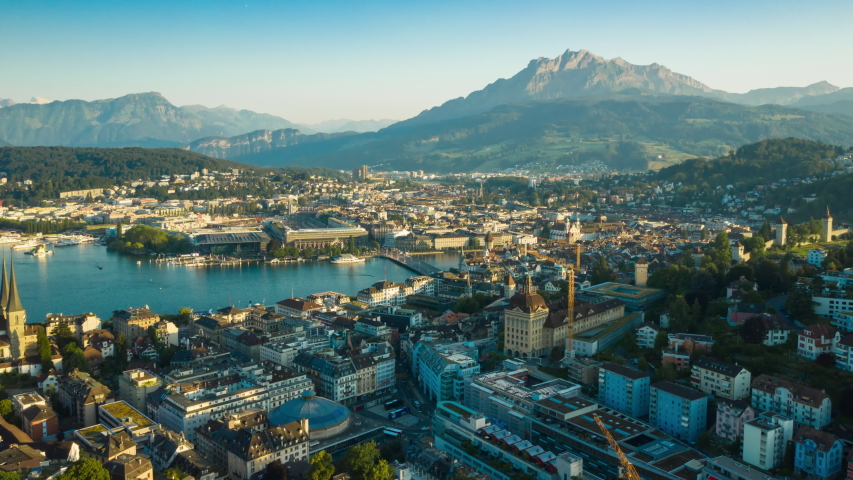LUZERN, SWITZERLAND - JULY 2 2019: sunny evening flight over luzern city lakeside bay mountains skyline aerial panorama 4k timelapse circa july 2 2019 luzern, switzerland.