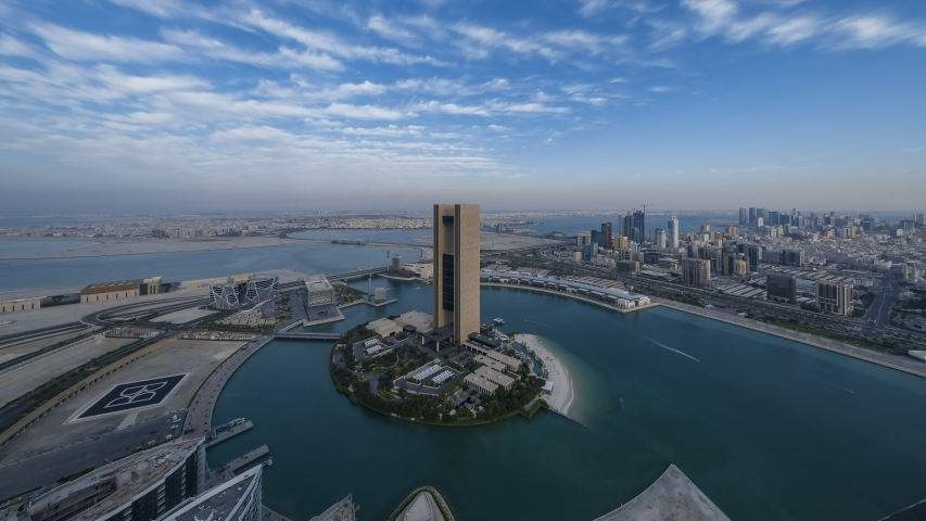 Manama, Bahrain - 27 December, 2019:  Aerial view of  of moving beautiful clouds over Four Season Hotel Bahrain and Juffair cityscape