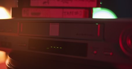 VHS video cassette recorder, tape inserted, play, stop, eject. exterior of VCR.