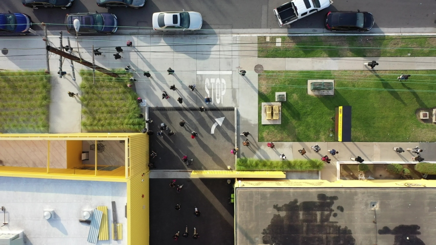 Aerial overhead 4K drone view of busy school or university as students leave campus. Modern architecture, education, yellow building, people walking. For commercials, b-roll, cutaways, ads, websites. | Shutterstock HD Video #1043680012
