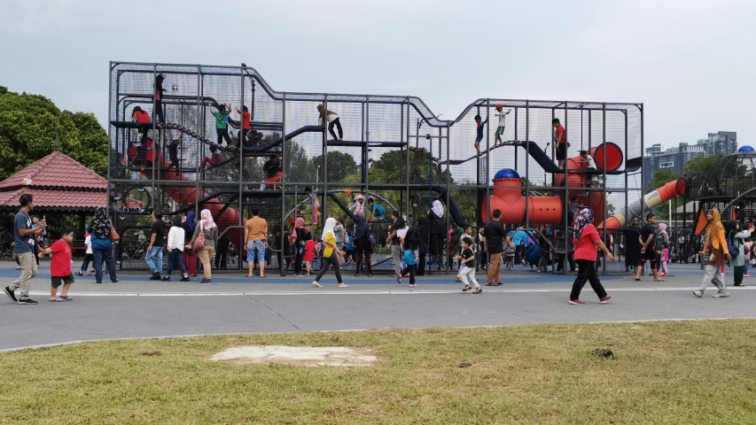 KUALA LUMPUR< MALAYSIA: 28 December 2019 - 4K time lapse of children playing at the newly open public park at Kuala Lumpur