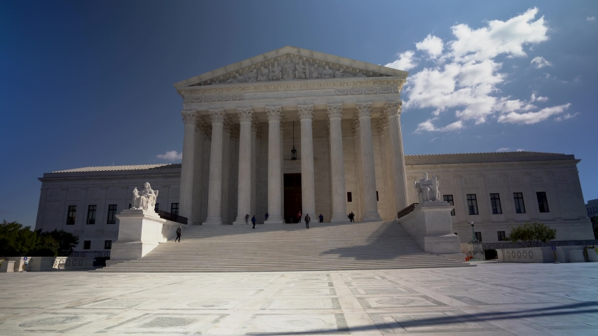 Wide camera motion to right of west facade of the Supreme Court building in Washington, DC. | Shutterstock HD Video #1043736949
