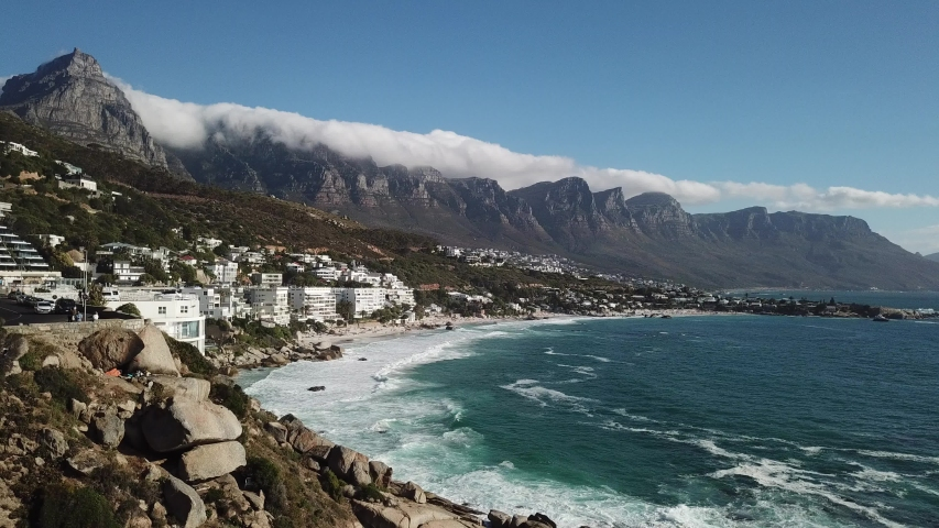 4K aerial summer sunny afternoon footage of spectacular scenic Clifton Beach, Lion's Head Mountain, cloudy Twelve Apostles in background, Atlantic Ocean coast in Western Cape, Cape Town, South Africa
