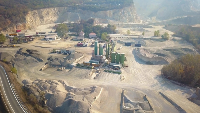 A stone excavation machinery at a quarry site | Shutterstock HD Video #1043751898