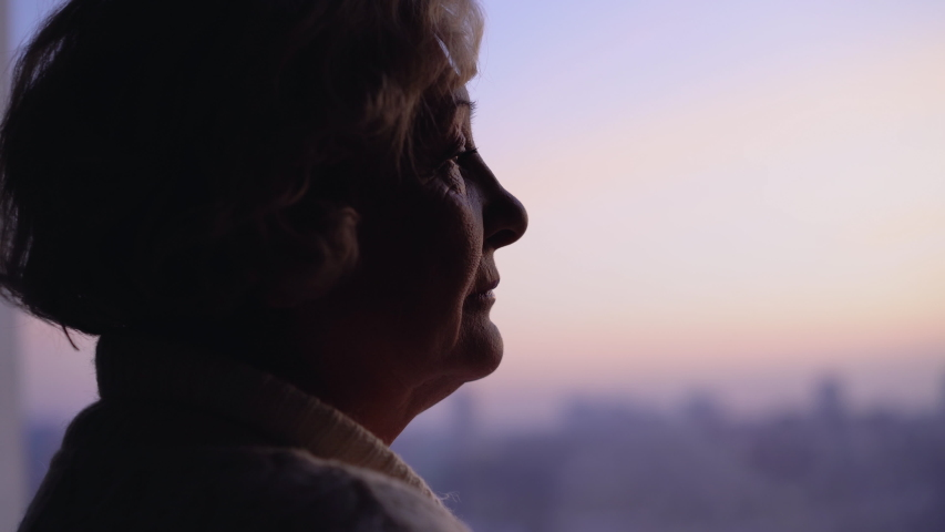 Unhappy wrinkled lady looking in window, suffering loneliness at senior age Royalty-Free Stock Footage #1043774272
