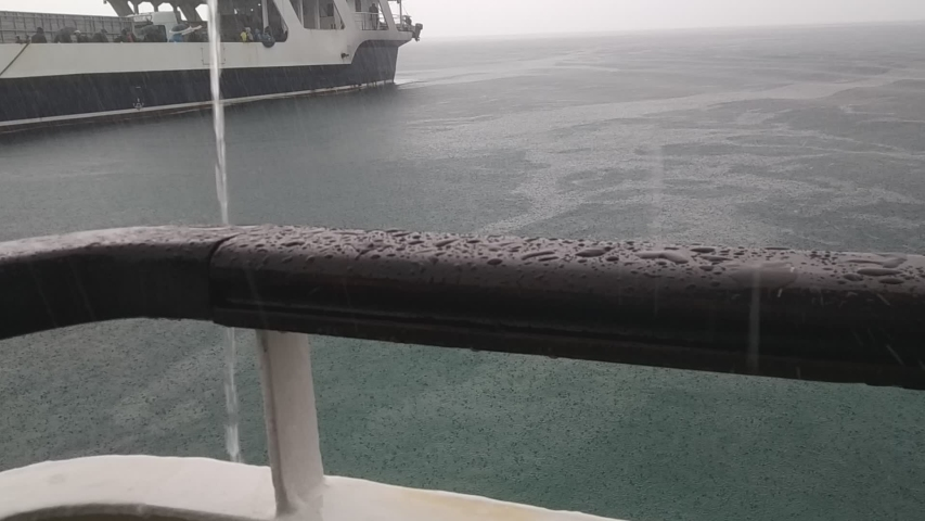 Close Up of Raindrops Falling on a Boat Porch in a Ocean Storm.