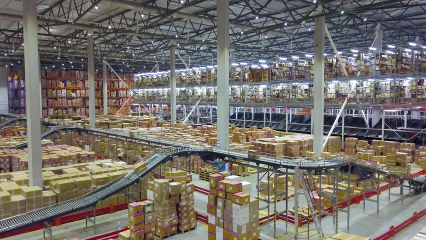 Modern technologies of storage and sorting in large warehouse Royalty-Free Stock Footage #1043852227