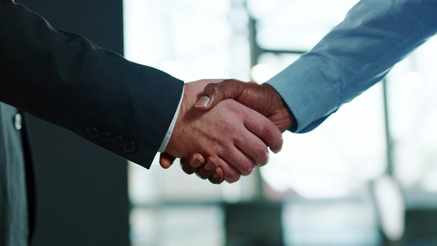 Close up hands business people shaking successful corporate partnership deal welcoming opportunity in office agreement professional greeting meeting colleagues partners slow motion
