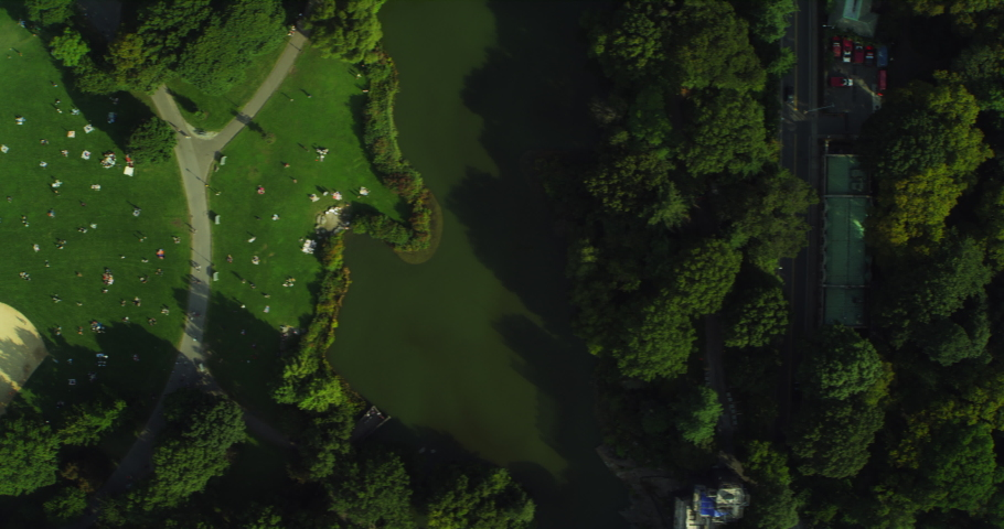 Aerial top down view of Central Park Manhattan in New York during the day under blue skies. Wide shot on 4K RED camera.