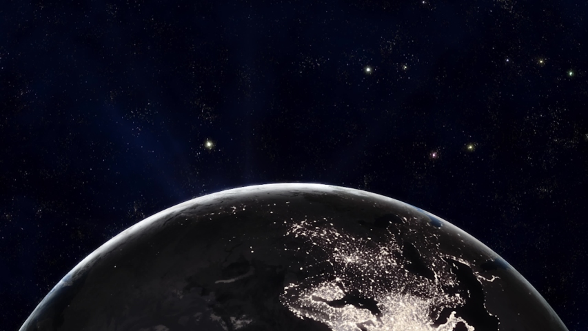 The Earth slowly rotating in space, backlit by the sun with the lights of the planet's cities visible on the surface. The sun drifts across frame as the world turns, revealing the continents at night. | Shutterstock HD Video #1043905957
