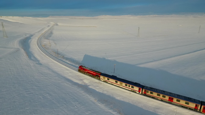 Aerial shot of Eastern Express at a snowy place. | Shutterstock HD Video #1043907685