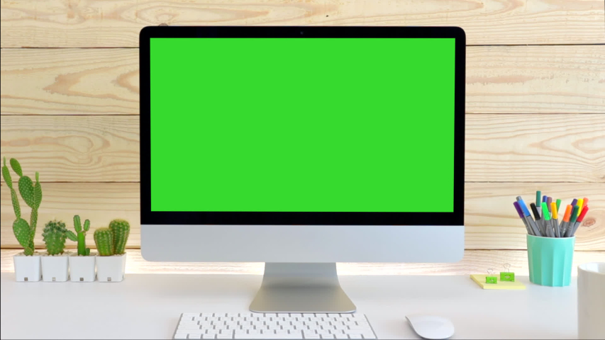Computer desktop with mock-up green screen white background  in office and  Lovely cactus in brown pot , Zoom shoulder view.   Shutterstock HD Video #1043908333
