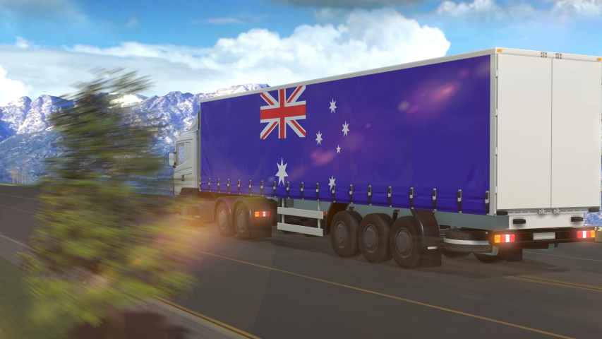 Australia flag shown on the side of a large truck driving on a highway