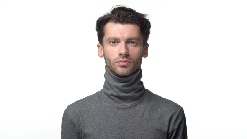Leisure, lifestyle and celebration concept. Slow-motion happy handsome bearded man in turtleneck sweater, start dancing and smiling, feeling lucky and happy, cheering, achieve success | Shutterstock HD Video #1043995345