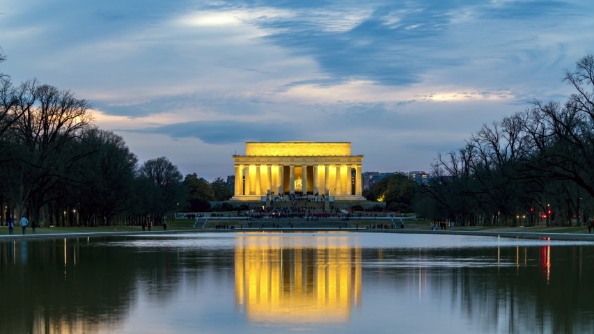 4K UHD Time lapse day to night of Abraham Lincoln Memorial in Washington, D.C. United states. Tourist attraction, us tourism, or American city lifestlye concept. Landmark and historical for travel.