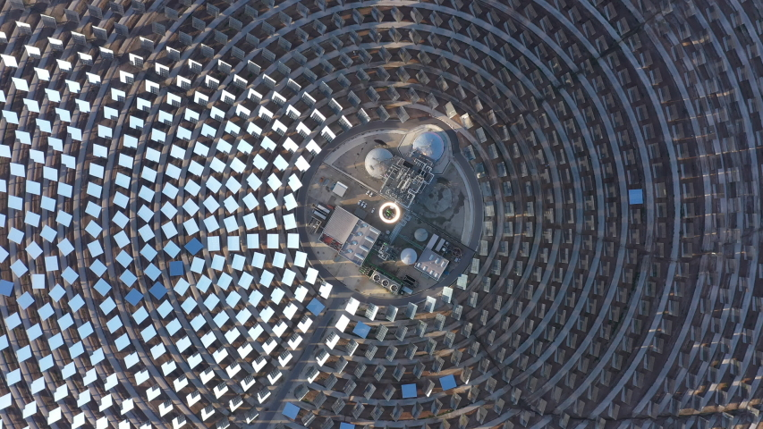 Beautiful aerial top shot over the concentrated solar power Gemasolar Spain giant abstract mirrors  Royalty-Free Stock Footage #1044022891