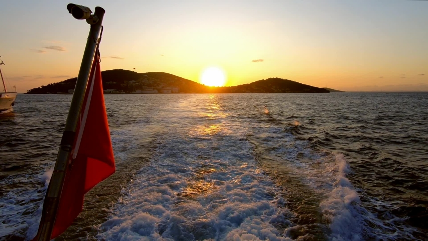 Sunset and birds accompanied by turkish flag from istanbul-islands ferry | Shutterstock HD Video #1044023467