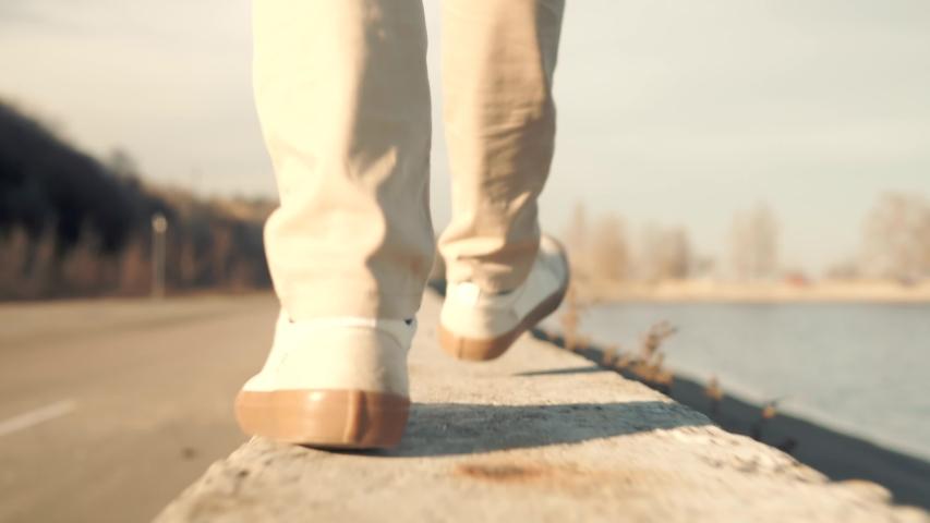Handsome Businessman Walks And Enjoying Good Weather At Fall.Confidence Man Feet Walking In City.Lonely Handsome Confident Businessmen In Pants Stroll Near River.Man Legs In Shoes Walking On Parapet.   Shutterstock HD Video #1044054067