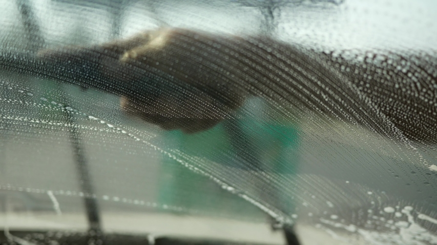 Woker cleaning the windshield at gas station. | Shutterstock HD Video #1044055615