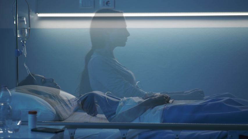 Female patient sleeping in a hospital bed at night, her soul leaves her body and goes away, near death experience concept